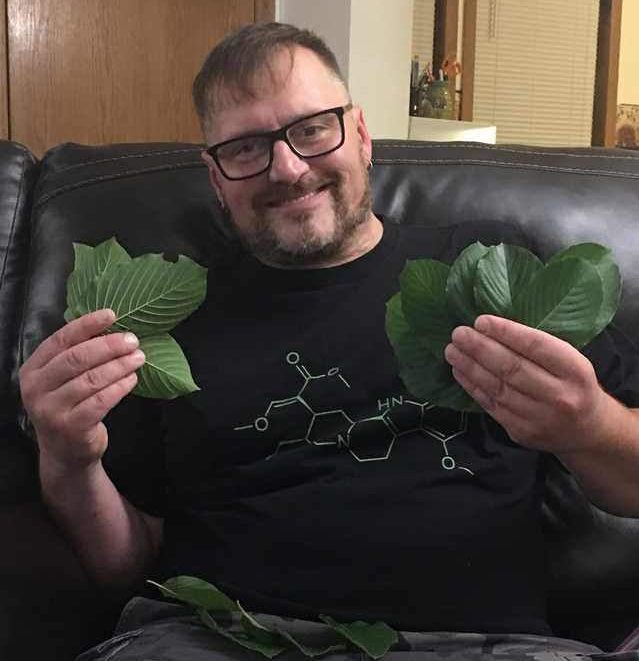 Customer holding fresh Kratom leaf